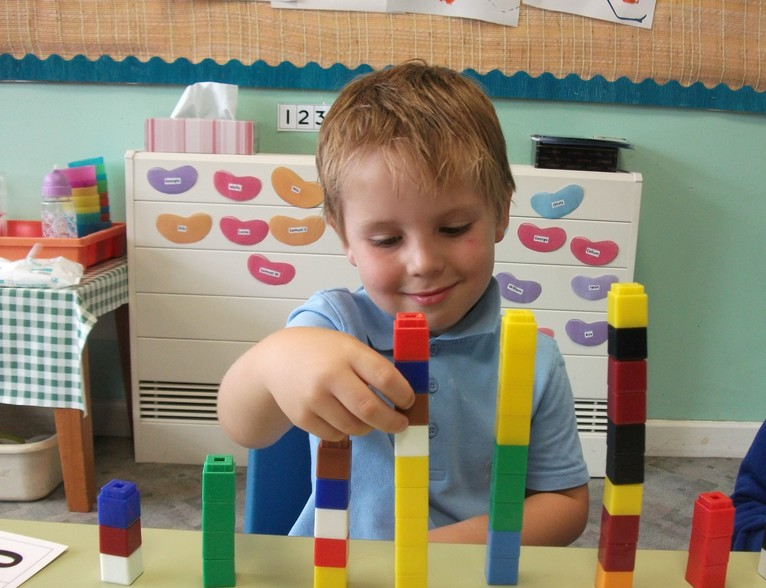 Preschool child building a tower
